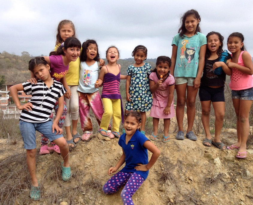 Some of our kids on the top of the hill. We will build the house right behind them.